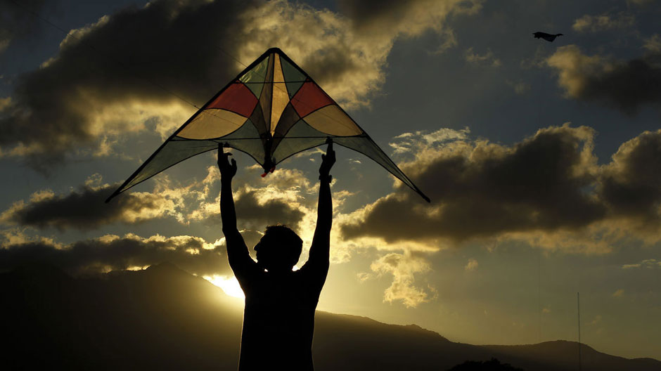 A man flies a kite at the Peace Park in San Jose, January 10, 2013.