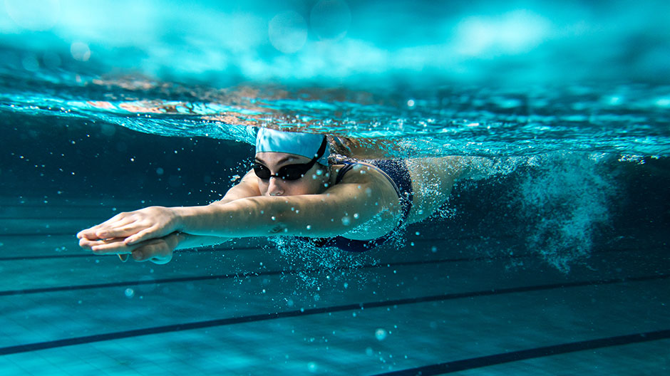 Lane swimmer glides smoothly through the water
